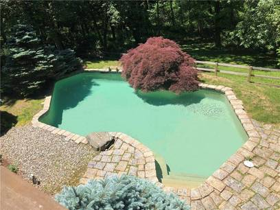Single Family Home Sold in Wilton CT 06897. Colonial house near river side waterfront with swimming pool and 2 car garage.