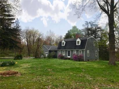 Single Family Home Sold in Weston CT 06883.  cape cod house near lake side waterfront with 2 car garage.
