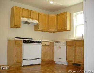 Condo Home For Sale in Stratford CT 06615.  townhouse near waterfront with 1 car garage.