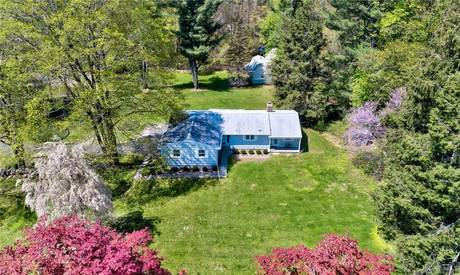 Single Family Home Sold in Ridgefield CT 06877. Ranch house near beach side waterfront with 2 car garage.