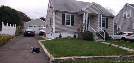 Single Family Home Sold in Stratford CT 06614.  cape cod house near beach side waterfront with swimming pool and 2 car garage.
