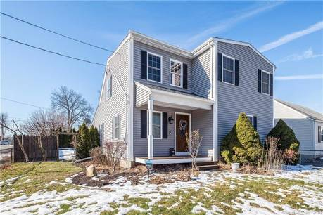 Single Family Home For Sale in Bridgeport CT 06606. Colonial house near waterfront with 1 car garage.