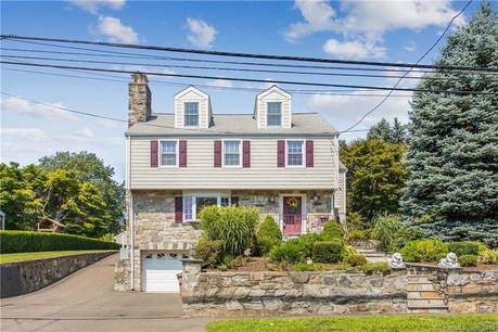 Single Family Home Sold in Stamford CT 06905. Colonial house near waterfront with swimming pool and 3 car garage.