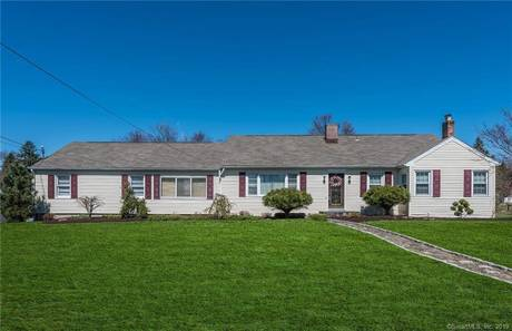 Single Family Home Sold in Danbury CT 06811. Ranch house near lake side waterfront with swimming pool and 2 car garage.