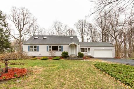 Single Family Home Sold in Ridgefield CT 06877.  cape cod house near waterfront with 2 car garage.