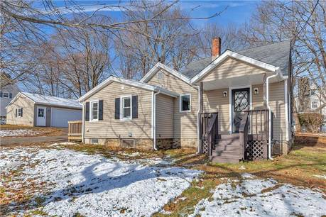 Single Family Home For Sale in Stratford CT 06614. Old  cape cod house near waterfront with 2 car garage.