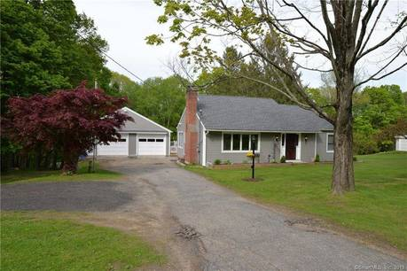 Single Family Home Sold in New Fairfield CT 06812.  cape cod house near beach side waterfront with 2 car garage.