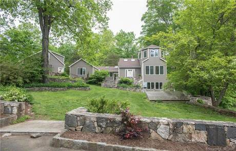 Single Family Home Sold in Wilton CT 06897. Old contemporary house near waterfront with swimming pool and 3 car garage.
