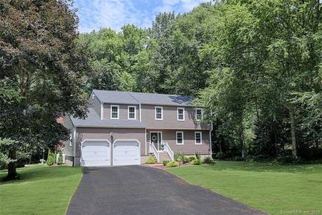 Single Family Home Sold in Trumbull CT 06611. Colonial house near beach side waterfront with 2 car garage.