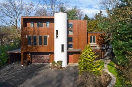 Single Family Home For Rent in Greenwich CT 06870. Contemporary house near waterfront with 2 car garage.