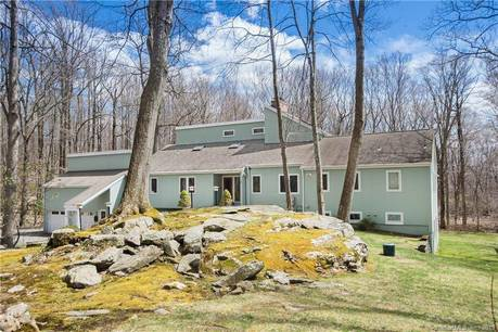 Single Family Home Sold in Ridgefield CT 06877. Contemporary cape cod house near waterfront with 3 car garage.
