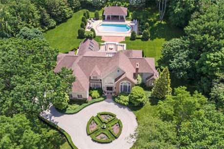 Single Family Home Sold in Fairfield CT 06824. Colonial house near beach side waterfront with swimming pool and 2 car garage.