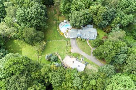 Single Family Home Sold in Ridgefield CT 06877.  cape cod house near river side waterfront with swimming pool and 2 car garage.