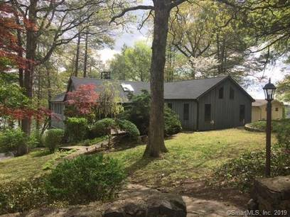 Single Family Home For Sale in New Fairfield CT 06812. Old contemporary house near beach side waterfront with 2 car garage.