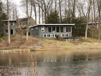 Single Family Home Sold in Ridgefield CT 06877. Ranch house near lake side waterfront with 1 car garage.