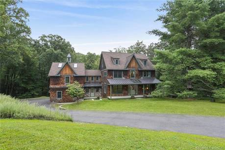Single Family Home Sold in Redding CT 06896. Colonial house near lake side waterfront with 2 car garage.