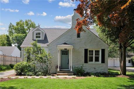 Single Family Home Sold in Fairfield CT 06824.  cape cod house near river side waterfront with 1 car garage.