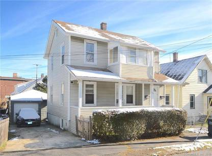 Multi Family Home For Sale in Bridgeport CT 06610. Old  house near beach side waterfront with 2 car garage.