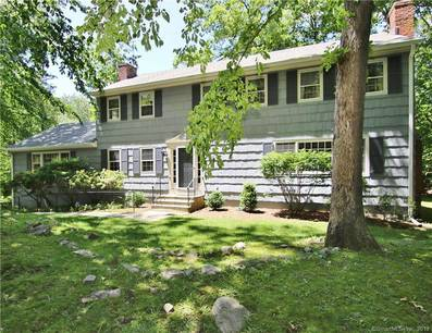 Single Family Home Sold in Stamford CT 06903. Colonial house near lake side waterfront with 2 car garage.