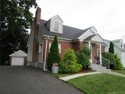 Single Family Home Sold in Bridgeport CT 06606.  cape cod house near beach side waterfront with 1 car garage.