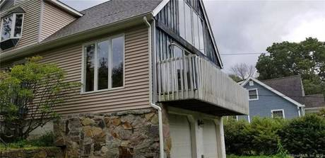 Foreclosure: Single Family Home Sold in New Fairfield CT 06812. Contemporary house near waterfront with 2 car garage.
