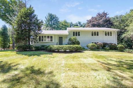 Single Family Home Sold in Westport CT 06880.  house near beach side waterfront with swimming pool and 2 car garage.