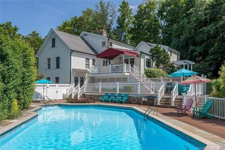 Single Family Home Sold in Brookfield CT 06804.  cape cod, cottage house near lake side waterfront with swimming pool and 4 car garage.