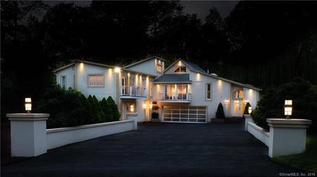 Single Family Home For Sale in Wilton CT 06897. Contemporary house near waterfront with 2 car garage.