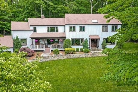 Single Family Home Sold in Weston CT 06883. Contemporary, colonial house near beach side waterfront with 3 car garage.