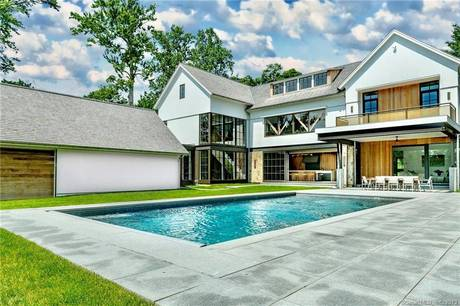 Luxury Mansion Sold in Westport CT 06880. Big contemporary, colonial house near beach side waterfront with swimming pool and 3 car garage.