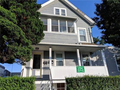 Multi Family Home Sold in Bridgeport CT 06606. Old  house near waterfront with 2 car garage.