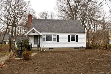 Single Family Home Sold in Fairfield CT 06825.  cape cod house near waterfront with 1 car garage.