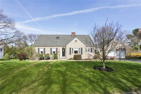 Single Family Home Sold in Trumbull CT 06611.  cape cod house near lake side waterfront with 2 car garage.