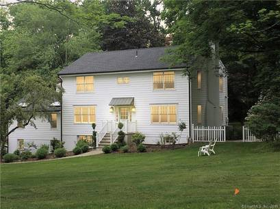 Single Family Home Sold in Westport CT 06880. Colonial house near lake side waterfront with 2 car garage.