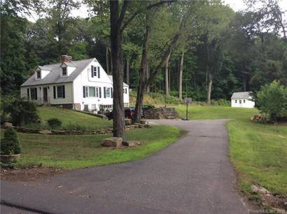 Single Family Home Sold in Monroe CT 06468.  cape cod house near river side waterfront with 1 car garage.