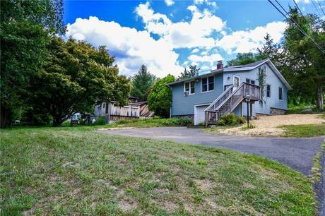 Single Family Home Sold in Danbury CT 06810. Old  bungalow, cape cod house near beach side waterfront with 1 car garage.