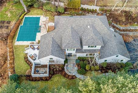 Single Family Home For Sale in Westport CT 06880. Contemporary, colonial house near beach side waterfront with swimming pool and 2 car garage.