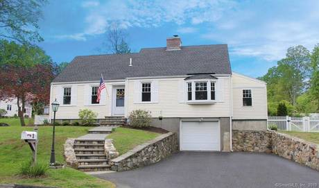Single Family Home Sold in Trumbull CT 06611.  cape cod house near waterfront with 1 car garage.