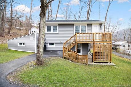 Single Family Home Sold in New Fairfield CT 06812. Ranch house near beach side waterfront.