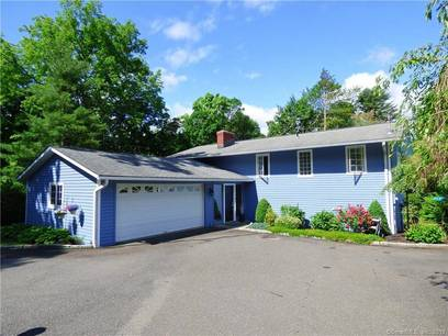 Single Family Home For Sale in Brookfield CT 06804. Ranch house near waterfront with 2 car garage.