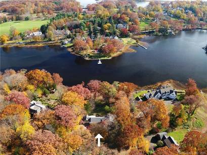 Luxury Single Family Home Sold in Darien CT 06820. Ranch house near river side waterfront with 2 car garage.
