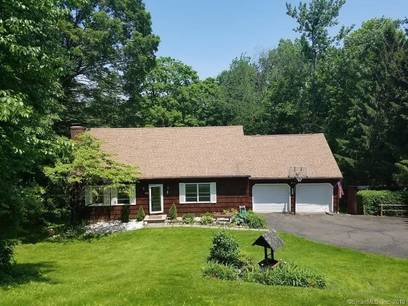 Single Family Home Sold in New Fairfield CT 06812.  cape cod house near waterfront with 2 car garage.