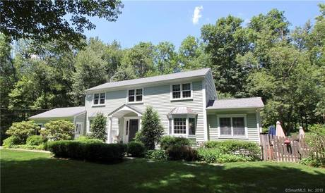 Single Family Home For Sale in Wilton CT 06897.  saltbox house near waterfront with swimming pool and 2 car garage.