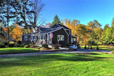 Single Family Home Sold in Trumbull CT 06611.  cape cod, farm house near waterfront with 2 car garage.