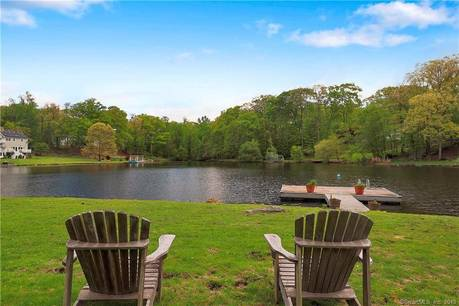 Single Family Home Sold in Stamford CT 06903. Ranch house near lake side waterfront with 2 car garage.