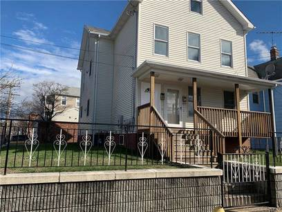 Multi Family Home Sold in Bridgeport CT 06604. Old  house near waterfront with 3 car garage.