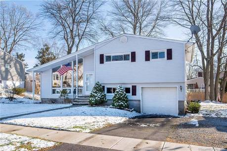 Single Family Home For Sale in Stratford CT 06614.  house near waterfront with 1 car garage.