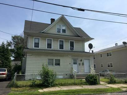 Multi Family Home Sold in Bridgeport CT 06604. Old  house near beach side waterfront with 2 car garage.