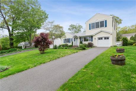 Single Family Home Sold in Greenwich CT 06870.  cape cod house near waterfront with swimming pool and 1 car garage.