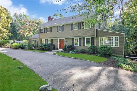 Single Family Home Sold in Weston CT 06883. Colonial house near beach side waterfront with swimming pool and 2 car garage.